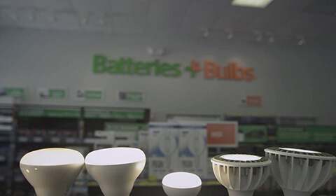 Photograph: Interior shot of Batteries+Bulbs store with various lightbulbs in foreground
