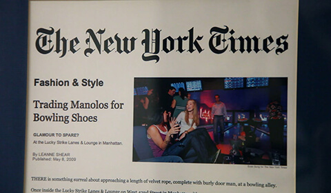 Photograph of framed New York Times Fashion & Style article highlighting Lucky Strike