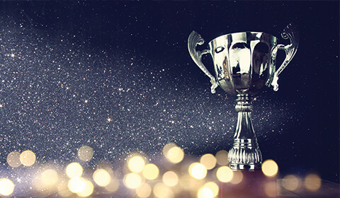 Photograph of trophy with glitter falling in background