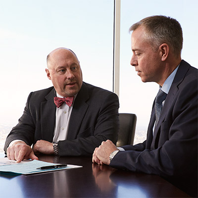 Two Baird Asset Management Associates in a meeting