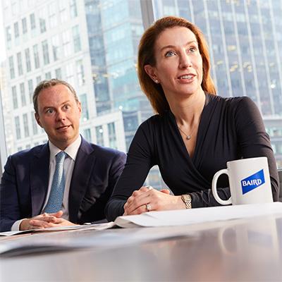 Two Baird ECM Associates in a meeting