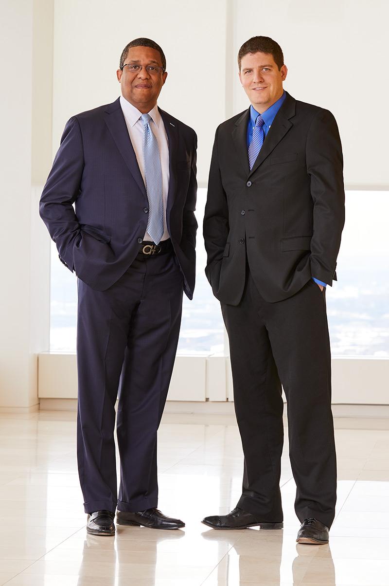 Portrait of two Baird FICM Associates