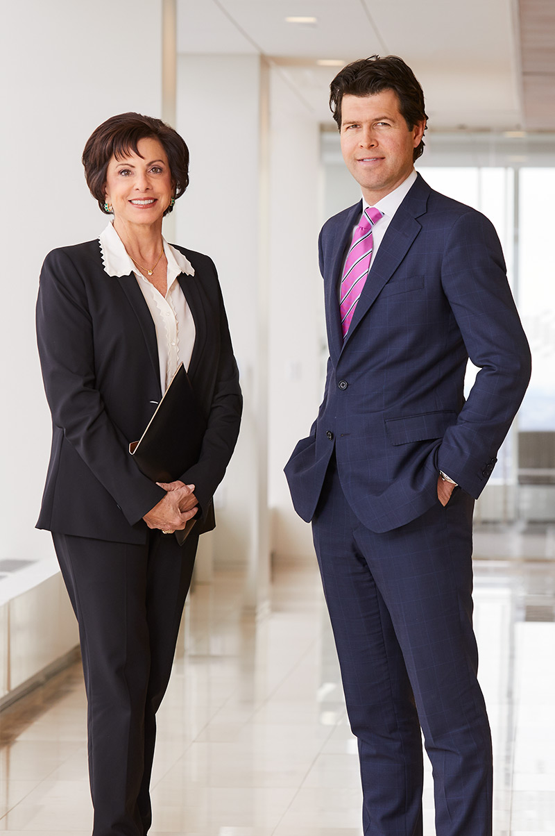 Portrait of two Baird PWM Associates