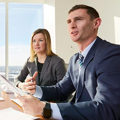 Two Baird PWM Associates in a meeting