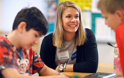 Baird Associate working with children.