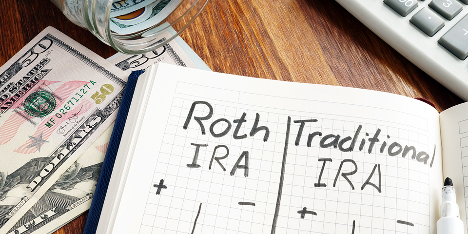 Writing on notebook - Traditional vs Roth IRA Pros and Cons.