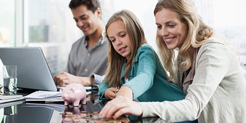 Mother and daughter counting coins.