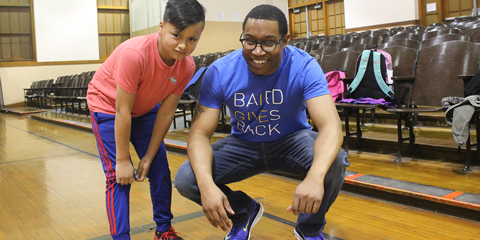 Baird Associate with Child in Gym