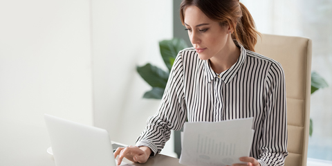 Woman looking at computer.