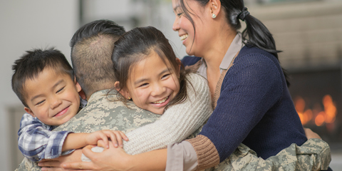 Military Man Hugging Family