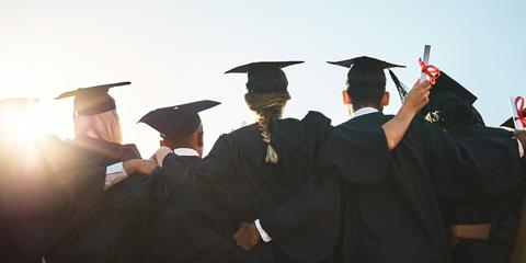 College Graduates Huddled Together