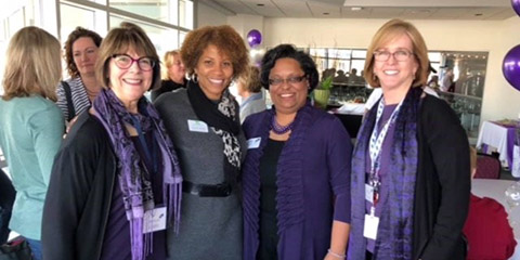 Photo of various Baird associates at firm's Women's Day event