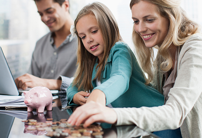 Parents and child counting coins