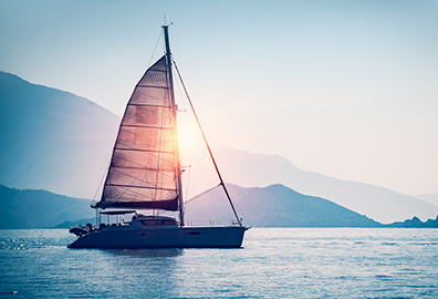 Sail boat on a calm lake