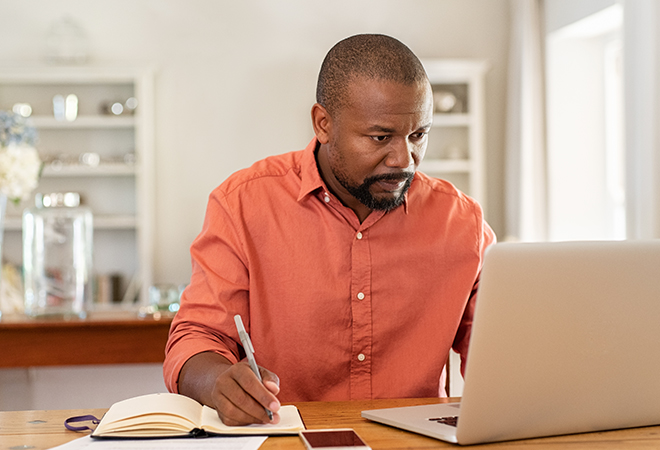 Man Looking at Finances on the Computer