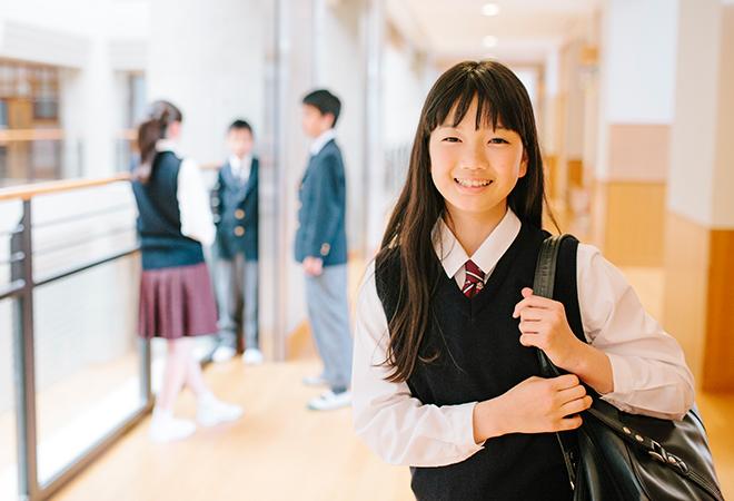 Female student standing in school hallway