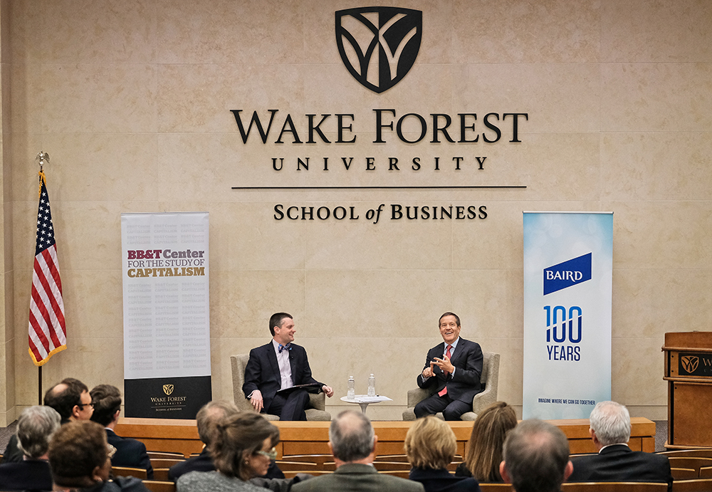 Taft (right) addresses attendees at the Wake Forest University School of Business on April 2 in North Carolina.