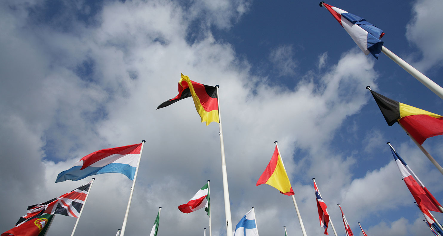 View of flags from different countries blowing in the wind