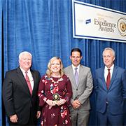 Baird associates posing with winner