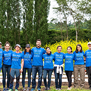 Group of Seattle associates voluntering at a farm.